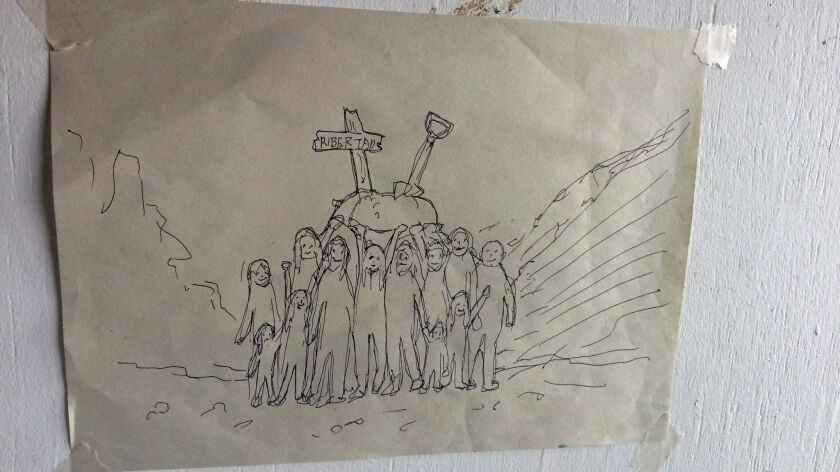 """A drawing inside the treehouse depicts the procession of children who carried a symbolic grave bearing the words """"Libertad."""""""