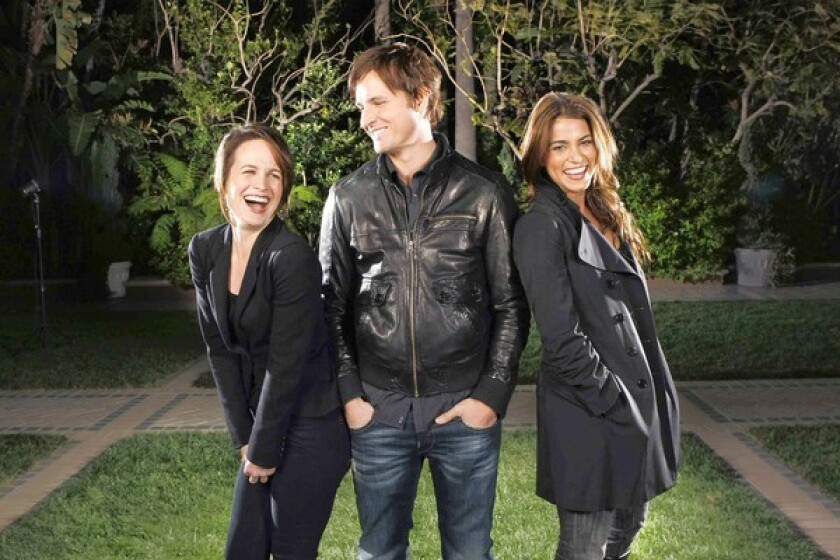 """KILLING TIME: Elizabeth Reaser, left, Peter Facinelli and Nikki Reed have a fight on their hands in the latest installment of the """"Twilight"""" franchise."""