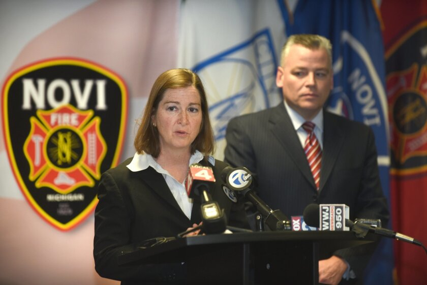 United States Attorney Barbara McQuade, Eastern District Michigan, speaks along side Novi Police Chief David Molloy during a press conference, Friday, Feb. 12, 2016, in Novi, Mich. The pair announced that Roger Tam and his wife Ada Lei, of Novi, were arrested during an going probe into the deaths o