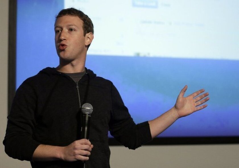 Facebook CEO faces ire over slumping stock at shareholder meeting