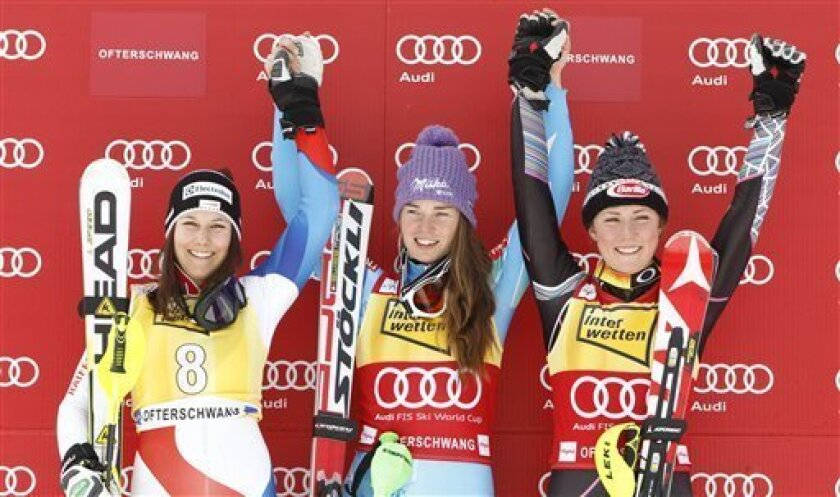 From left, Wendy Holdener, of Switzerland, second placed, Tina Maze, of Slovenia, the winner and Mikaela Shiffrin, of United States, third placed celebrate on podium after an alpine ski, women's World Cup slalom, in Ofterschwang , Germany, Sunday, March 10, 2013. (AP Photo/Giovanni Auletta)