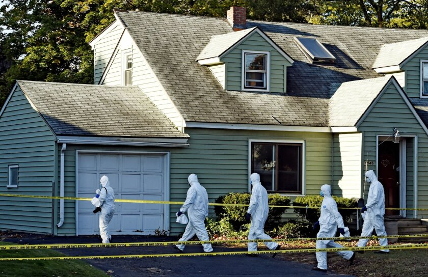 FILE - In this Oct. 9, 2014, file photo, authorities prepare to enter the scene of a quadruple homicide in Guilderland, N.Y., where Jin Chen, his wife and their two children were found fatally stabbed. Investigators since then have worked despite language barriers, cultural differences and the logi