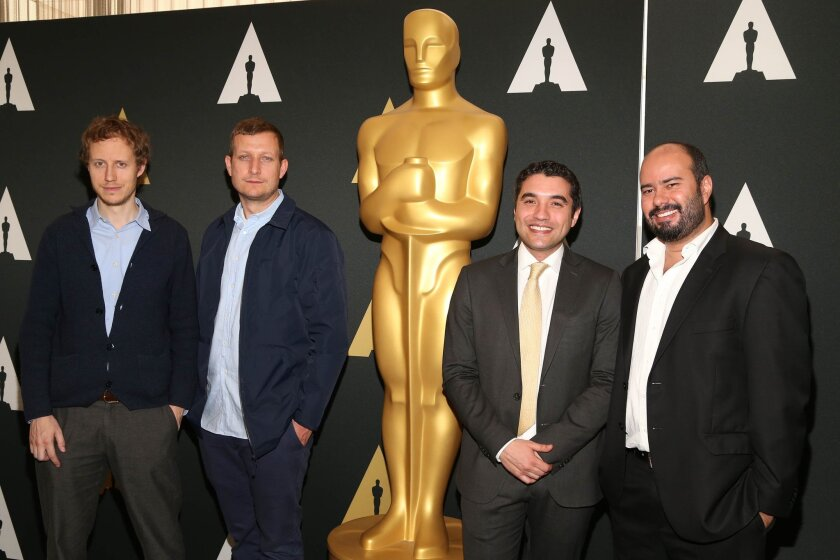 László Nemes, left, Tobias Lindholm, Naji Abu Nowar and Ciro Guerra arrive at the 88th Academy Awards Foreign Language Films at Samuel Goldwyn Theater on Saturday, Feb. 27, 2016, in Beverly Hills, Calif. (Photo by Omar Vega/Invision/AP)