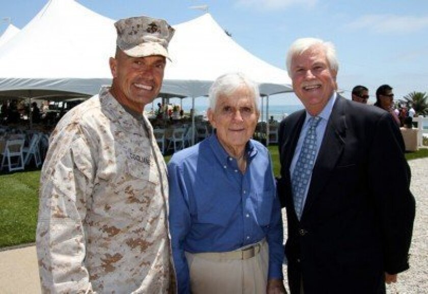 Camp Pendleton Brigadier General Vincent Coglianese, Tom Hurt and Bob Clelland during the dedication of five new vacation cottages at Camp Pendleton on June 18.