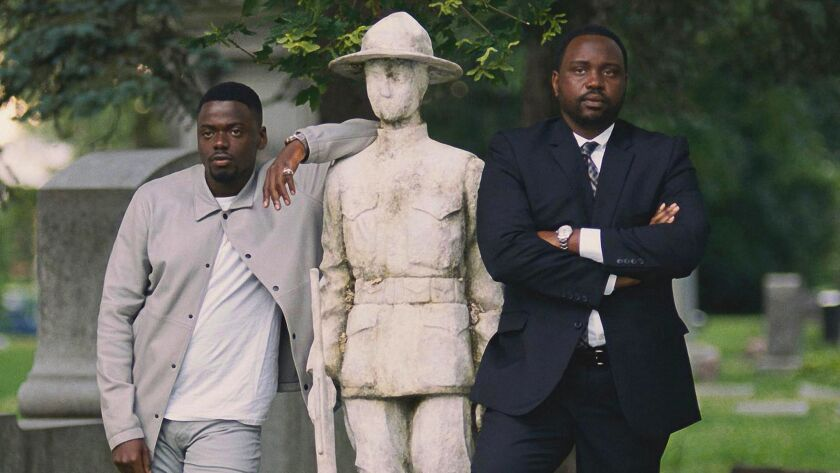 This image released by 20th Century Fox shows Daniel Kaluuya, left, and Brian Tyree Henry in a scene