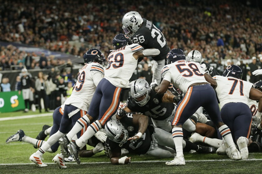 Oakland Raiders running back Josh Jacobs leaps over the line to score a touchdown during the second half of a 24-21 victory over the Chicago Bears.