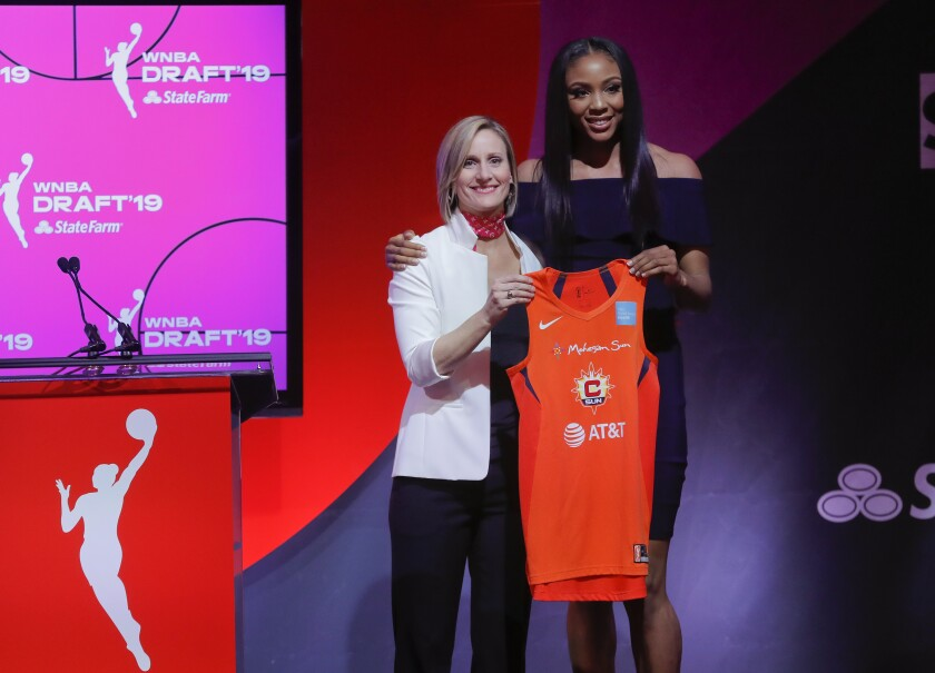 Kristine Anigwe, right, poses with WNBA COO Christy Hedgpeth in the WNBA draft on April 10, 2019, in New York.