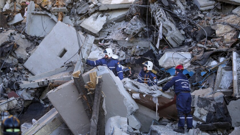 Emergency Situations employees working at the scene of a collapsed apartment building in Magnitogors