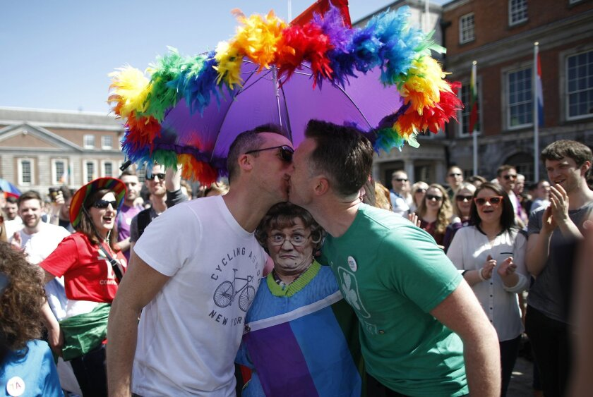 Two men kiss as first results start to filter through in the referendum, Dublin, Ireland, Saturday, May 23, 2015. Ireland has voted resoundingly to legalize gay marriage in the world's first national vote on the issue, leaders on both sides of the Irish referendum declared Saturday even as official