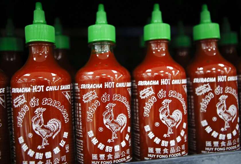 Sriracha sauce lining a store shelf last month. But for how long?