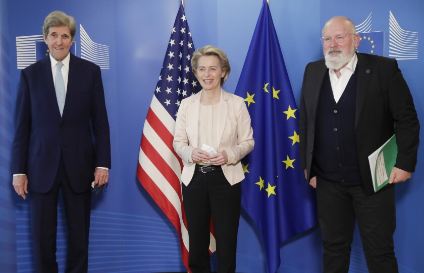 FILE - In this March 9, 2021 file photo, United States Special Presidential Envoy for Climate John Kerry, left, European Commission President Ursula von der Leyen, center, and European Commissioner for European Green Deal Frans Timmermans pose for photographers prior to a meeting at EU headquarters in Brussels. The European Union reached a tentative climate deal on Wednesday, April 21, 2021 that should make the 27-nation bloc climate-neutral by 2050, with member states and parliament agreeing on the targets on the eve of a virtual summit that U.S. President Biden will host. (Olivier Hoslet, Pool via AP, File)