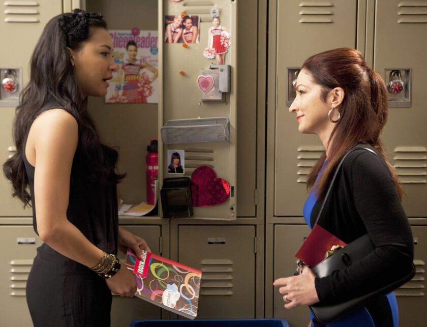"Naya Rivera, left, with Gloria Estefan on ""Glee."""