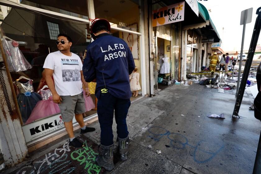 LOS ANGELES CA JULY 11, 2019 -- LAFD arson investigator Gus Gaeta on scene in the 1200 block of Wall