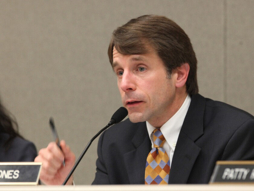 California Insurance Commissioner Dave Jones is facing off with insurer State Farm over whether the state can order insurers to cut insurance rates retroactively. The case could test the strength of landmark insurance law Proposition 103.