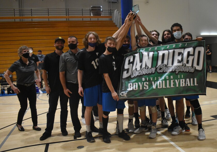 The Ramona High Bulldogs boys volleyball team celebrate after winning the CIF Division II title on June 5.