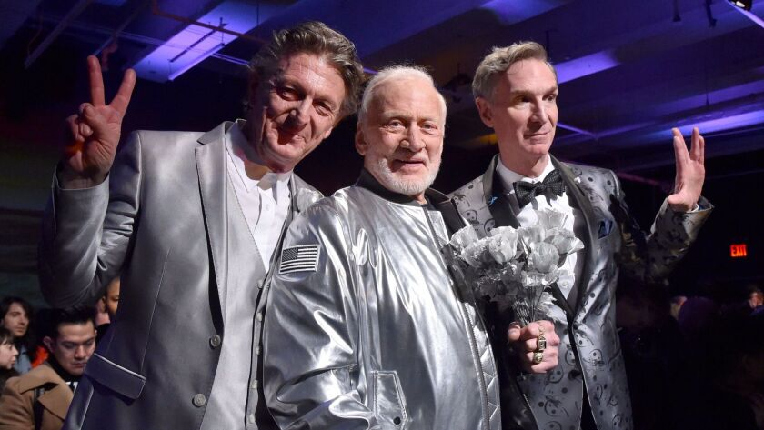 Nick Graham from left, Buzz Aldrin and Bill Nye