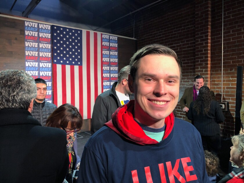 College student Myles Hammond, 22, attends a Mike Bloomberg event, Monday, Feb. 3, 2020 in Sacramento, Calif. On the day the 2020 election kicks off in Iowa, Bloomberg is going his own way in California. Hammond, of. Parker, Colo., is wavering on his vote, mostly between Bloomberg and Bernie Sanders. (AP Photo/Michael R. Blood)