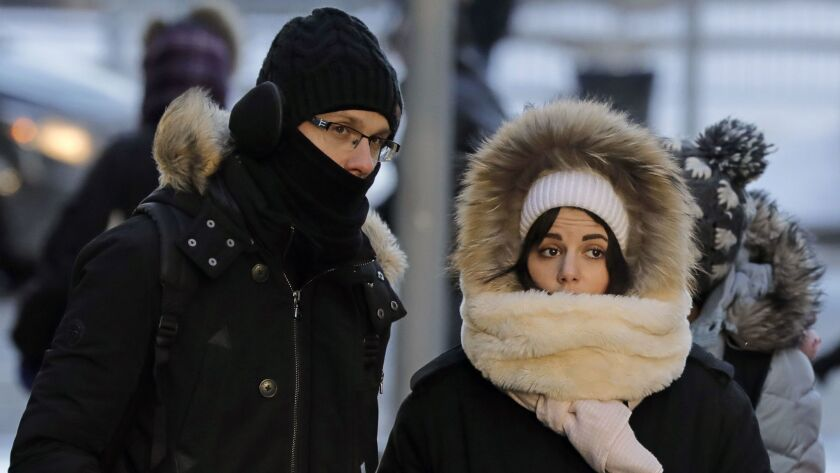 Pedestrians bundle up against the sub-zero temperatures in New York, on Jan. 6, 2018. A massive cold front hit the Eastern Seaboard.