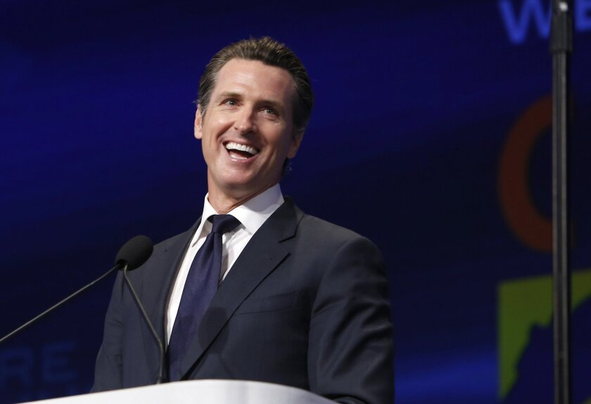 Lt. Gov. Gavin Newsom laughs during his speech at the 2013 Democratic State Convention in Sacramento.