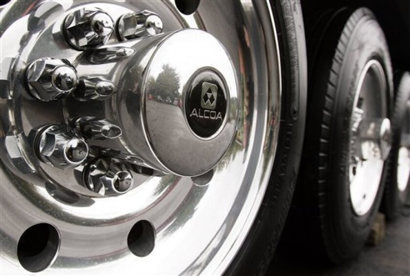 In this Sept. 23, 2005 file photo, a set of polished aluminum Alcoa wheels are seen on a trailer parked at an auto customizing shop in Warrendale, Pa. Alcoa Inc., the world's third-largest aluminum producer, reports fourth-quarter results on Monday, Jan. 12, 2009.  (AP Photo/Keith Srakocic, File)