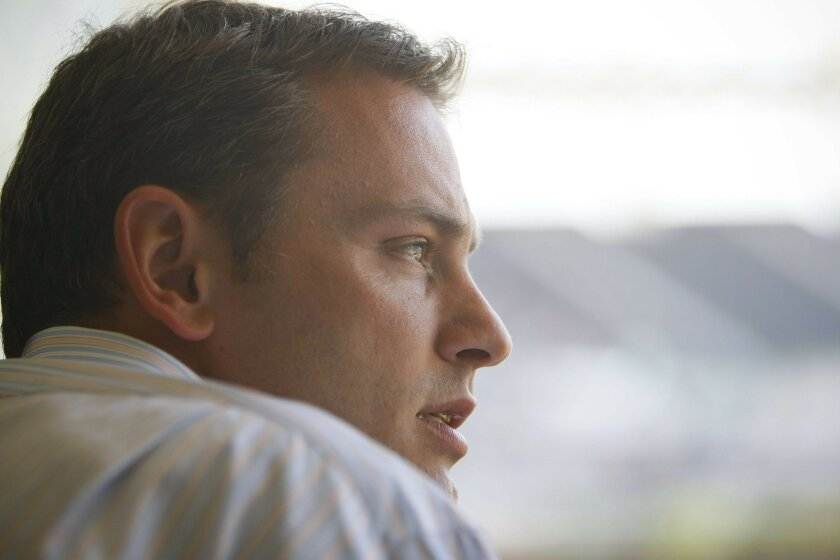 Jed Hoyer, shown during 2010 game, made good moves and bad moves during his two seasons as Padres general manager.