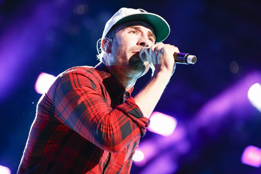 FILE - In this June 11, 2015 file photo, Sam Hunt performs at LP Field at the CMA Music Festival n Nashville, Tenn. Hunt is nominated for two Grammys for best country album and best new artist. The Grammys will air live, Monday, Feb. 15, on CBS at 8 p.m. ET.  (Photo by Al Wagner/Invision/AP, File)