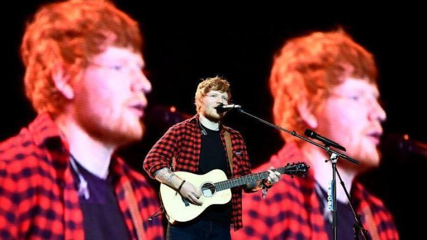 Ed Sheeran performs at the 2017 Glastonbury Festival in England, where he headlined the closing day. (Photo by Dylan Martinez / Reuters)
