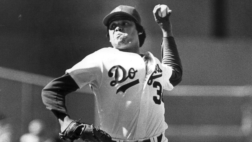 Dodgers pitcher Fernando Valenzuela delivers a pitch during a game in April 1984.
