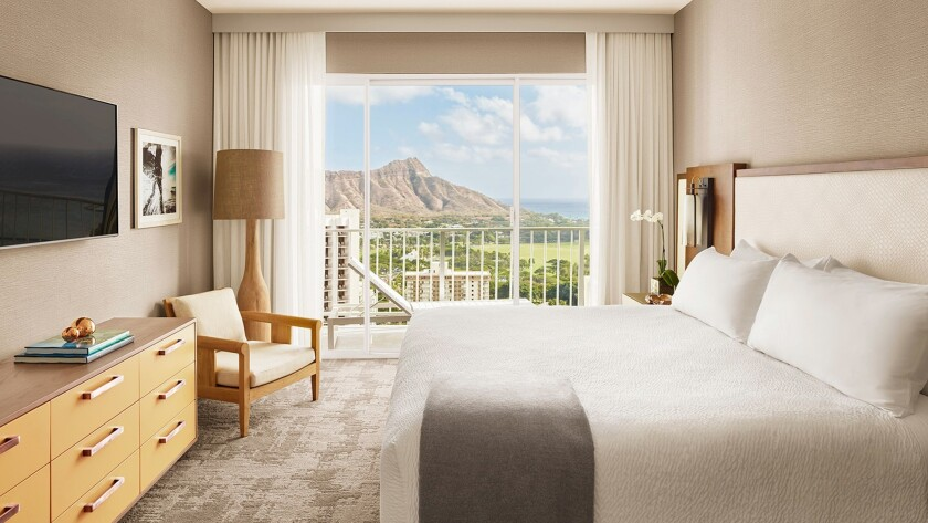Rooms at the newly named Alohilani Resort feature ocean views and vistas of Diamond Head.