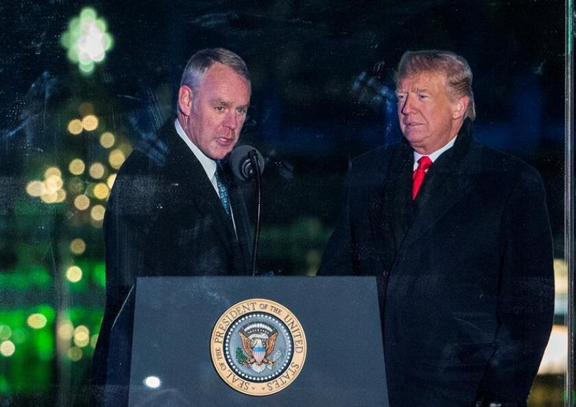 US President Donald J. Trump (R) and US Secretary of the Interior Ryan Zinke (L) participate in the 2018 National Christmas Tree Lighting at The Ellipse in President's Park south of the White House in Washington, DC, USA, on Nov. 28, 2018 (reissued 15 December 2018). EPA-EFE/ERIK S. LESSER
