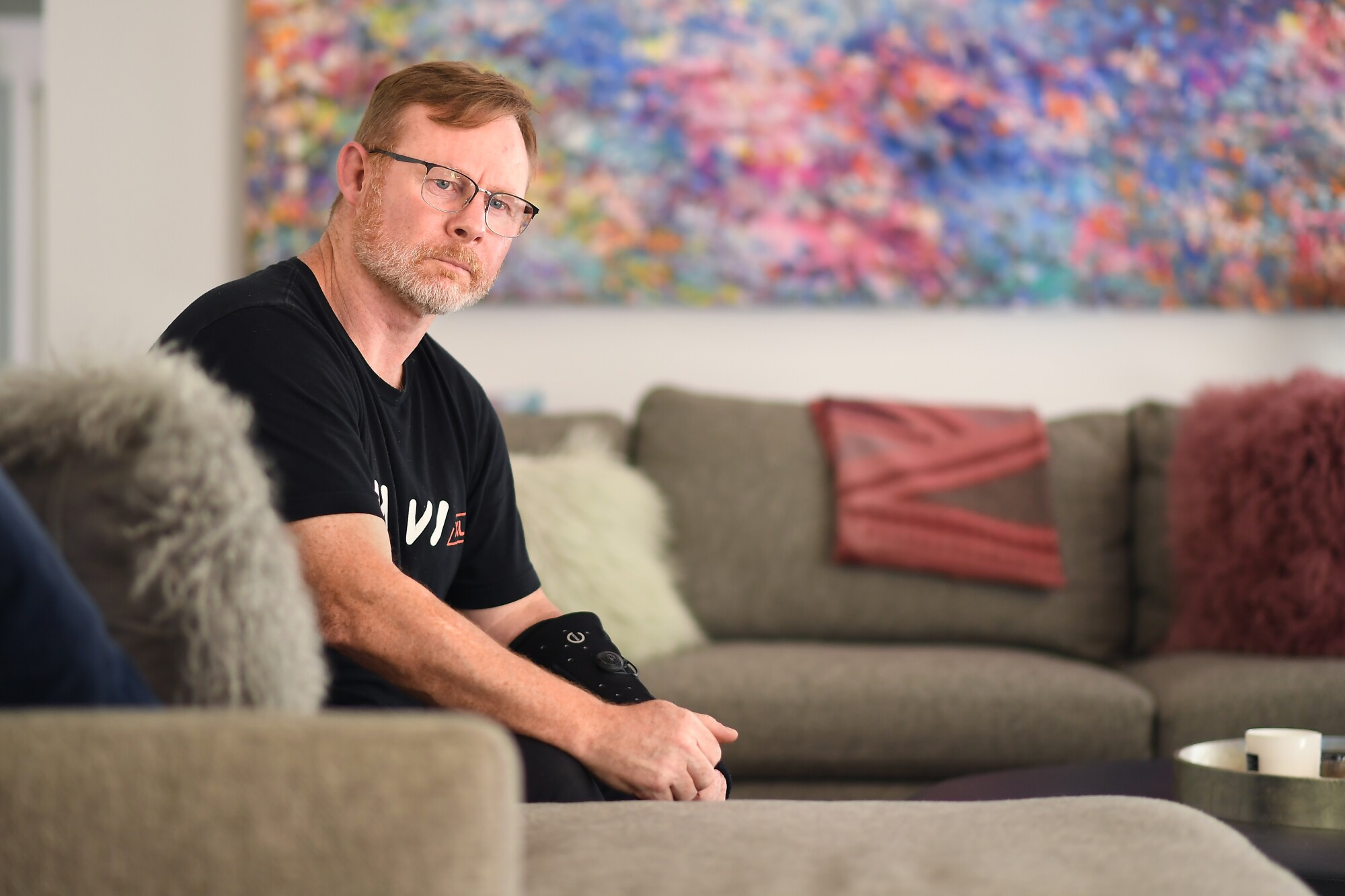 Former Hollywood trainer, boxer and fight sequencer Nigel Hudson poses on a couch.