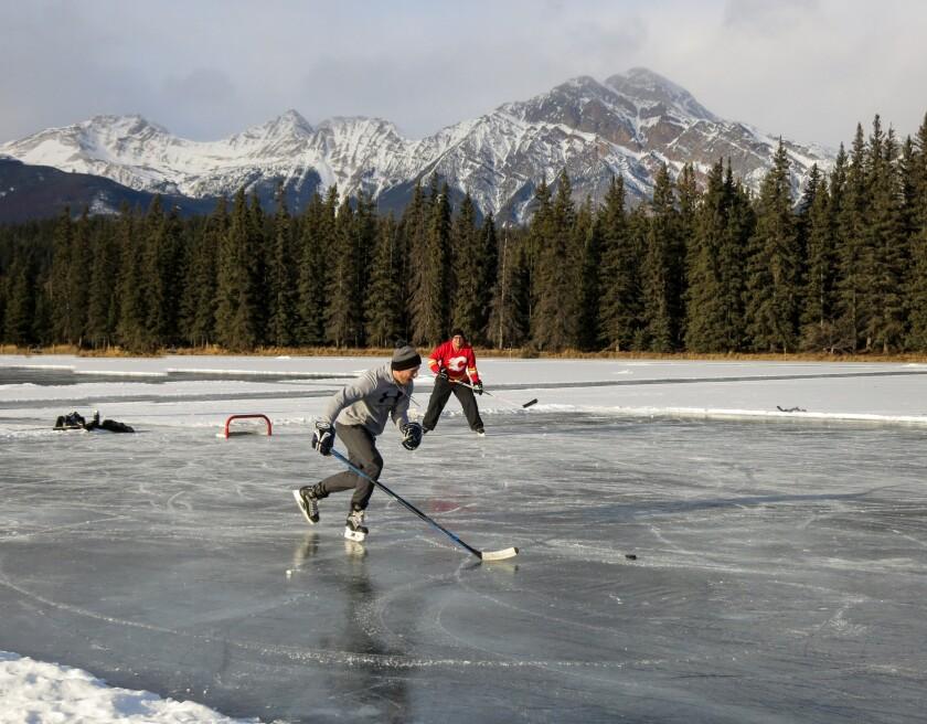 Men playing Hockey at Mildred Lake.