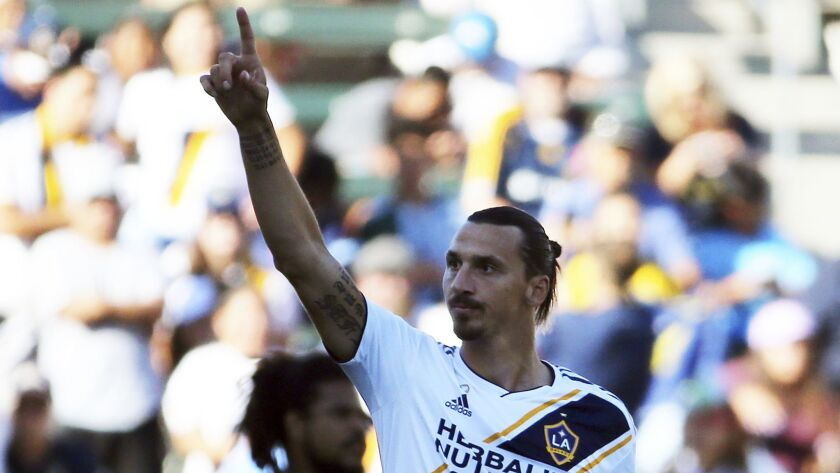 LA Galaxy forward Zlatan Ibrahimovic (9) celebrates his goal against the Seattle Sounders in the fir