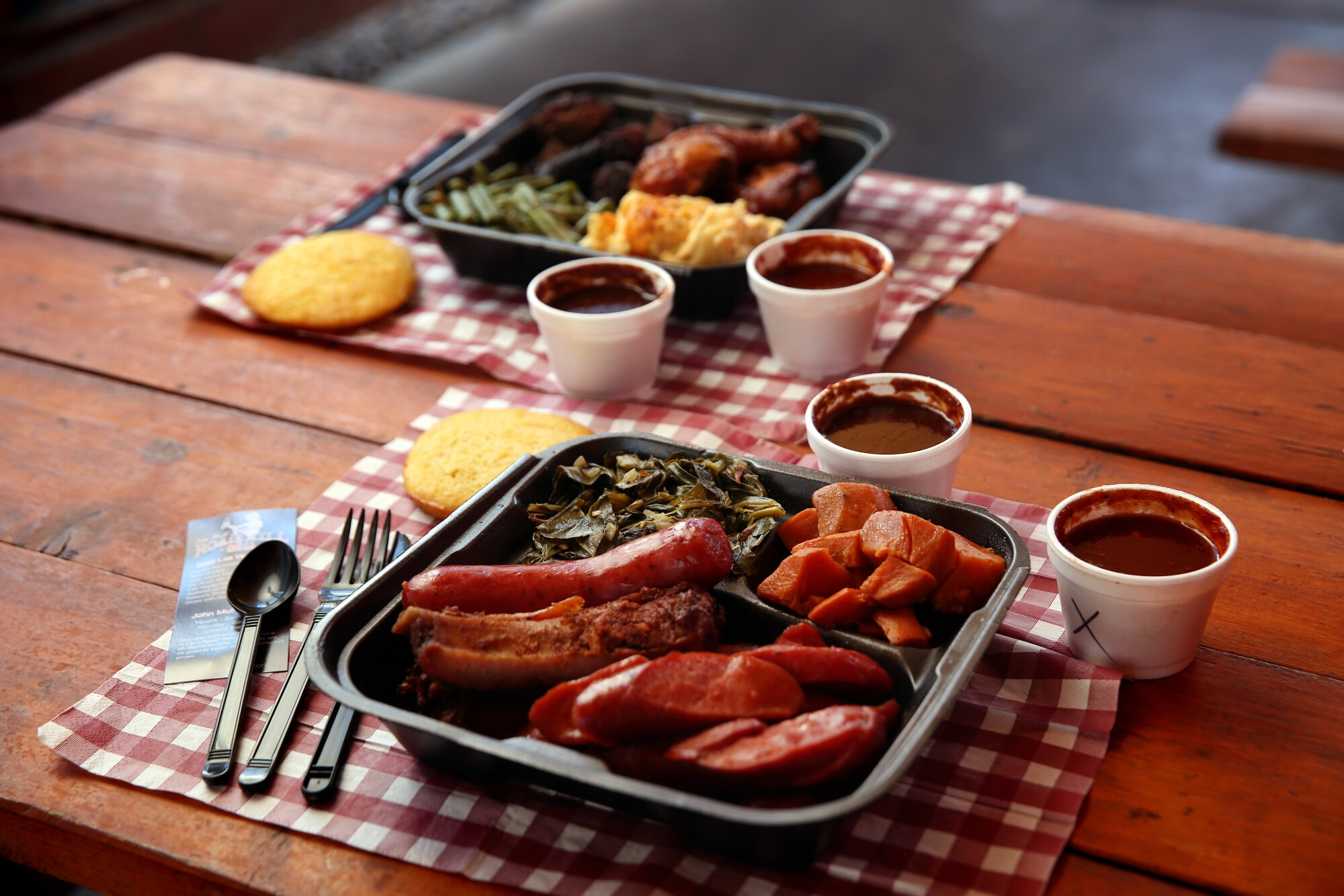 A dinner plate of hot links, collard greens and yams at John Mull's Meats & Road Kill Grill on in Las Vegas.