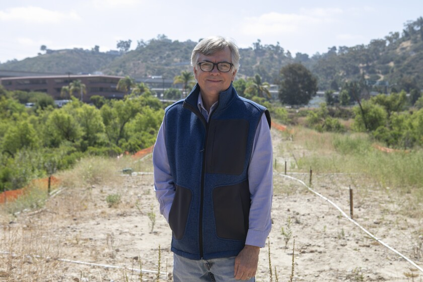 Rob Hutsel, standing along the San Diego River bed near Mission Valley.
