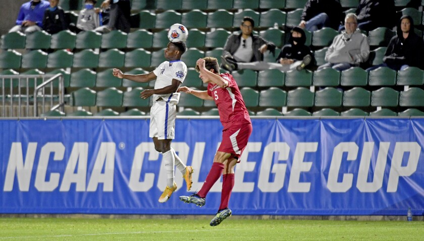 Pittsburgh's Alexander Dexter goes for a header against Indiana's Daniel Munie in the first half of the semifinal of the NCAA soccer College Cup, Friday, May 14, 2021, in Cary,N.C. (Matt Freed/Pittsburgh Post-Gazette via AP)