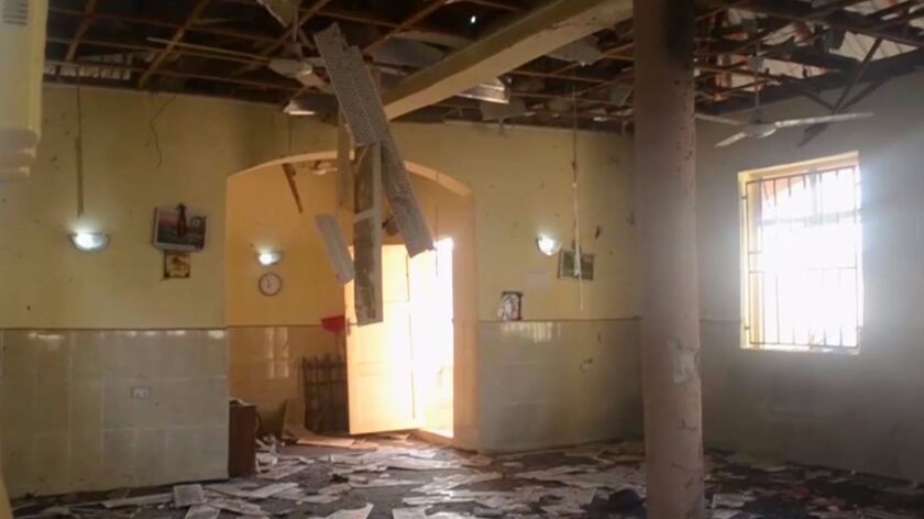 This image taken from TV shows the interior of a mosque after a deadly attack by a suicide bomber in Mubi, Nigeria, on Tuesday, Nov. 21, 2017.
