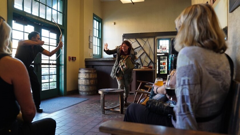 "Actors perform a zombie-themed story during ""Written in Stone,"" a quintet of one-acts presented at Stone Brewing Bistro & Gardens at Liberty Stations as part of La Jolla Playhouse's 2019 Without Walls Festival."