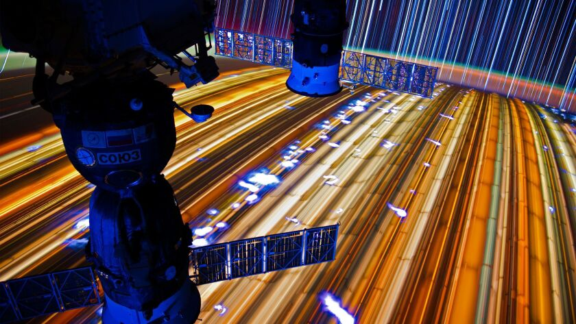 """A time-lapse photo of star trails taken from the International Space Station is part of astronaut Donald R. Pettit's new book, """"Spaceborne."""""""
