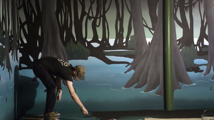 "LOS ANGELES, CA -- JUNE 15, 2018: Intern Michael Kuehler paints a story room based on ""The Raft"" gam"