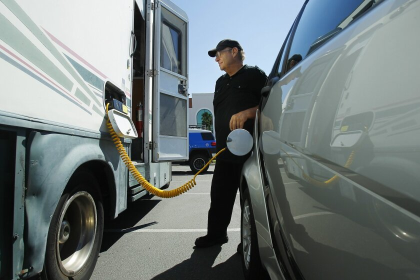 Tim Lemieux, a retired electronic engineer, can use energy from his solar panel-covered RV to charge electric cars. K.C. Alfred • U-T