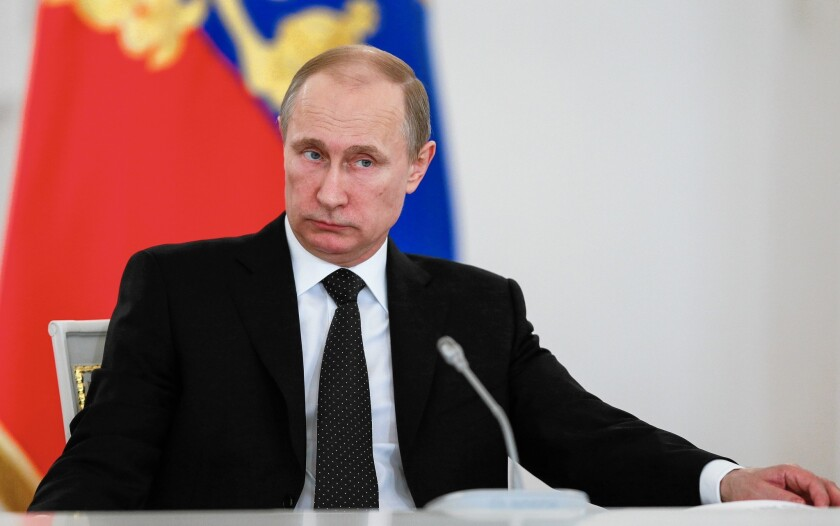 Russian President Vladimir Putin attends a meeting of the Victory Day celebrations organizing committee in the Kremlin in Moscow on Tuesday.