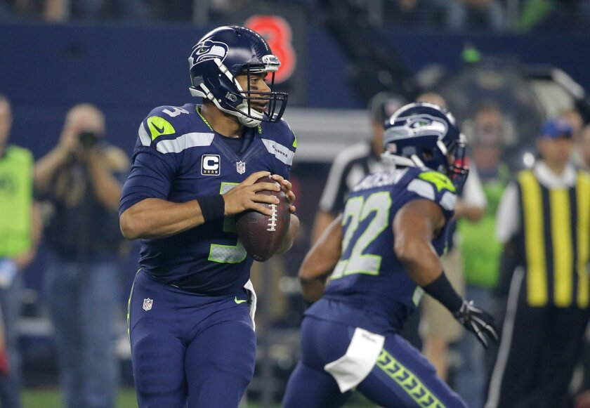 Seattle Seahawks' Russell Wilson (3) prepares to pass against the Dallas Cowboys in the first half of an NFL football game Sunday, Nov. 1, 2015, in Arlington, Texas. (AP Photo/Brandon Wade)