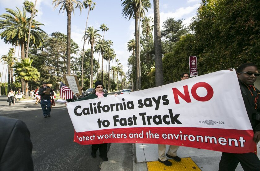 """Protesters take to the streets of Beverly Hills on May 7 to oppose """"fast tracking"""" the Trans-Pacific Partnership."""