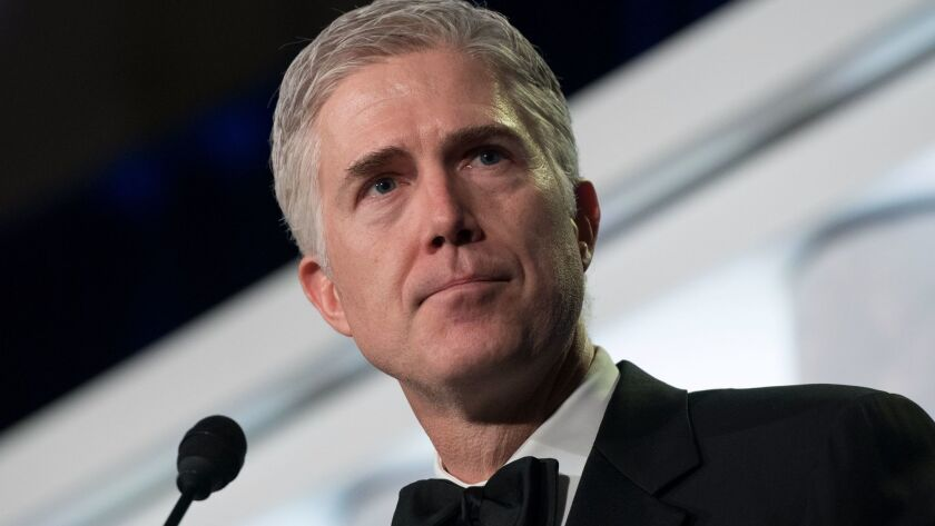 Supreme Court Justice Neil M. Gorsuch speaks at the Federalist Society's 2017 National Lawyers Convention in Washington on Nov. 16.