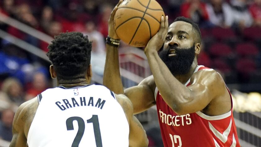 Houston Rockets' James Harden shoots over Treveon Graham.