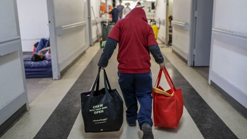 MCALLEN, TEXAS, SATURDAY, JANUARY 19, 2019 - A young immigrant boy carries his belongings through th