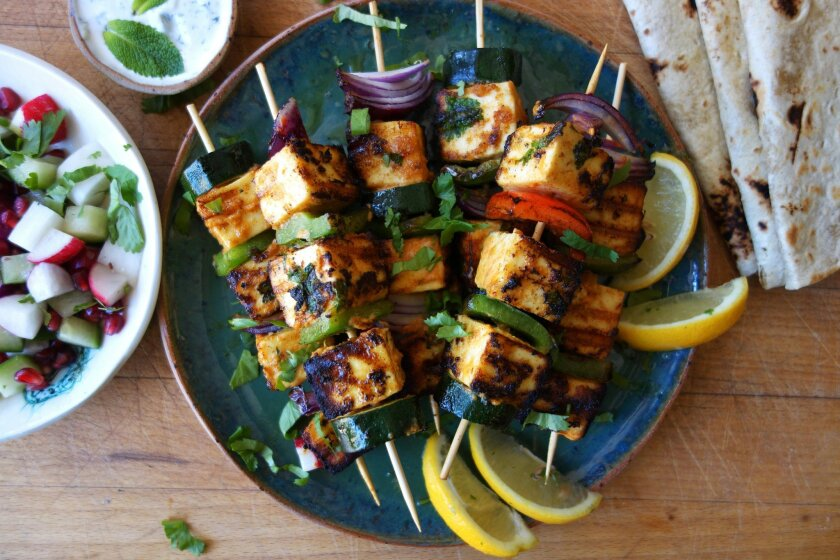 This May 26, 2016 photo shows spicy grilled paneer in London. Paneer is Indian unsalted white cheese. It has a mild flavor so takes to marinades really well and unlike most cheeses, it can be grilled without melting so that it softens in the middle and chars on the edges. (AP Photos/Meera Sodha)