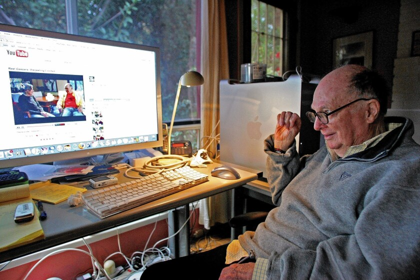 """In this photo from 2007, screenwriter Lorenzo Semple Jr. watches a clip of himself and veteran agent Marcia Nasatir on """"Reel Geezers,"""" an online show in which the pair would give acerbic reviews of current fims."""