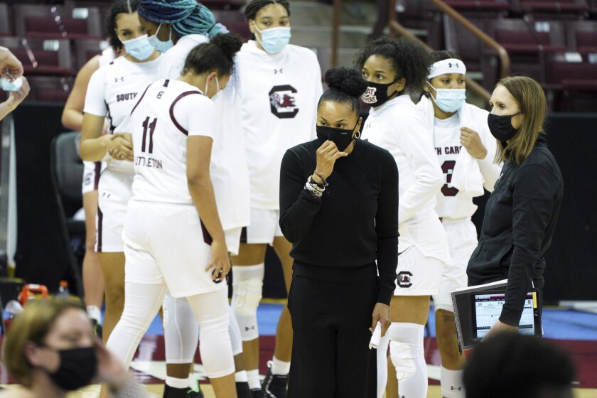 South Carolina head coach Dawn Staley, left, stands on the sideline with assistant coach Lisa Boyer after an NCAA college basketball game against Charleston, Wednesday, Nov. 25, 2020, in Columbia, S.C. (AP Photo/Sean Rayford)